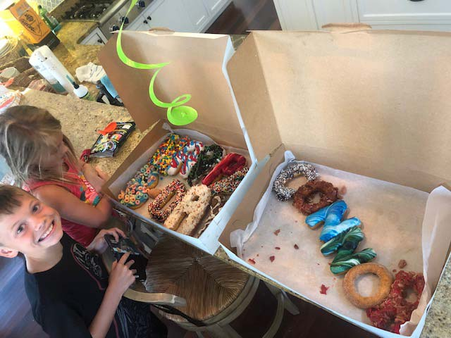 Connor with his Happy Birthday donut cake from 30A Donut Hut